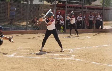 Softball Scores Big Time in Home Openers