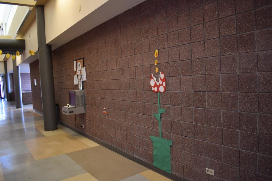 Angry flower collects the coins in Upper D Hall